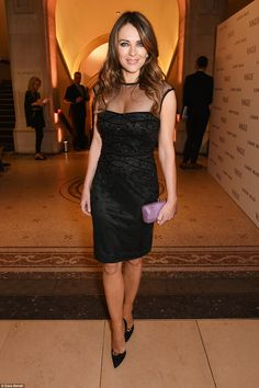 Bedazzling: Elizabeth Hurley showed off her amazing figure as she strutted into the museum in a sheer-detailed little black dress