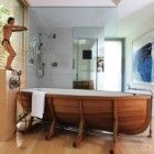 Top 10 Wonderful and Inviting Bathroom Design Ideas: White Modern Wooden Floor Bathroom Design with Unique Boat Shaped Bathtub | Home and Interior Design Ideas | Swiftsorchids