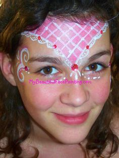 Pink Lace crown face paint.  Background done in Tag pink.  White detail work is DFX. Apply pink jewels with eye-lash glue.