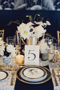 #place-settings, #table-numbers, #plates  Photography: Khaki Bedford Photography - khakibedfordweddings.com  Read More: http://stylemepretty.com/2013/08/22/black-gold-inspired-photo-shoot-from-khaki-bedford-photography-jonica-moore/