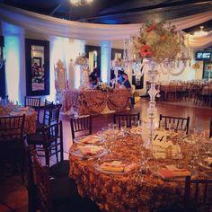 Bride and groom at center stage #wedding #weddingideas #chandelierfloralarrangement #crystalwedding