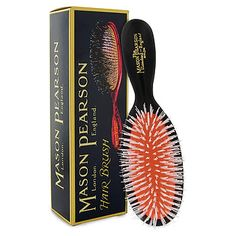 Mason Pearson Nylon Brush. Pricey, but a keeper. The only brush that's come close to brushing through my insanely thick hair.