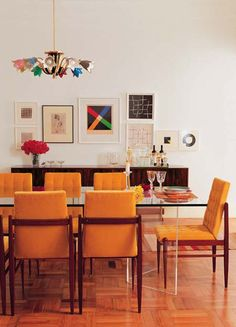 retro dining room I think of this when I think of my glass table- combining wood and glass.... Help me find chairs!!