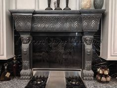 This polished Charcoal Grey Granite fireplace features regal lion head carvings on the legs and vertical Acanthus leaf carving accents banding the mantle header. Click on the picture to learn more. #Stone #Design #Art #Fireplace