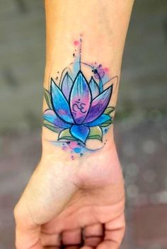 Watercolor Wrist Lotus Flower Tattoo ★ Best lotus tattoo designs gallery, check out to choose your favorite one. ★ Tattoo 53 Best Lotus Flower Tattoo Ideas To Express Yourself Lotusblume Tattoo, Up Tattoos, Wrist Tattoos, Tattoo Fonts, Body Art Tattoos, Sleeve Tattoos, Cool Tattoos, Lotus Tattoo Wrist, Awesome Tattoos