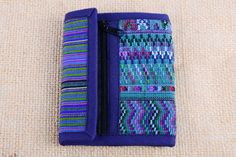 Check out this item in my Etsy shop https://www.etsy.com/listing/221509852/guatemalan-fabric-tri-fold-unisex-wallet