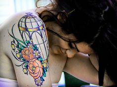 colored birdcage tattoo