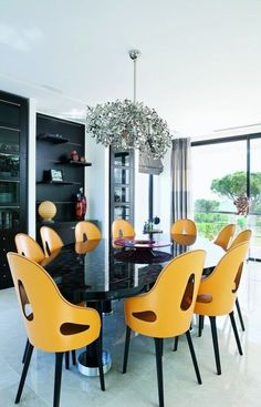 Dining room yellow (I do like the pop of yellow, but I would choose a different style) #stacylondon