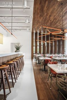 Rene Gonzalez Architect channeled a perfect indoor-outdoor environment for Miami's Plant Food + Wine restaurant and bar. Wrapping the main dining area, bamboo plywood sits beneath seating upholstered in pleasant contrast to the pale grey Bar Interior Design, Bar Design, Interior Design Magazine, Commercial Interior Design, Cafe Interior, Design Lab, Interior Exterior, Commercial Interiors, Interior Architecture
