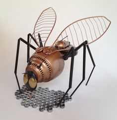 upcycled metal yard art sculpture - Betina Bee. $325.00, via Etsy.