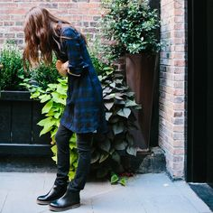 noticed: dresses over pants. stylist brie welch is wearing a madewell blue and black check plaid daywalk shirtdress, skinny skinny jeans in black frost and the black leather faux-crepe sole ray boot. #denimmadewell