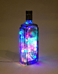 Items similar to Lighted Bottle. Recycled Hand Decorated Ukrainian Vodka Bottle with 100 LED Multicolor Lights Inside. on Etsy Diy Crafts For Girls, Diy Home Crafts, Summer Crafts, Kid Crafts, Bottle Candles, Bottle Lights, Diy Bottle, Vodka Bottle, Neon Crafts