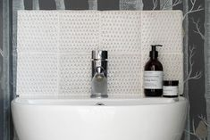Our beautiful Dove House Handmade Tiles have been used as a pretty splashback in this downstairs cloakroom.