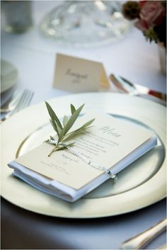 Olive leaf table setting | Image by Patrice Lariven, see more http://www.frenchweddingstyle.com/jenny-packham-dress-june-wedding-provence/