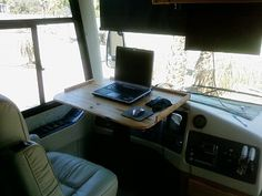 Custom steering wheel computer table.  Especially in a Class C, turning the cab into usable space would be a good idea.  We hang thermal curtains from the cabover bed to isolate the cab, so this would give a little privacy to one of the boys if they wanted to watch a movie or something.