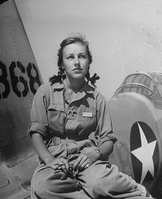 Shirley Slade, pilot trainee in Women's Flying Training Detachment, she sits on wing of her Army trainer at Avenger Field, July 1943. #vintage #1940s #women