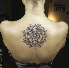 Interesting cat mandala tattoo lol..