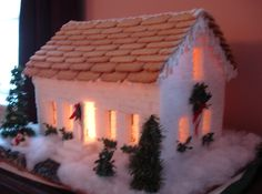 A sugar cube house, lit from the inside.