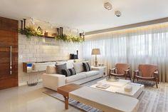 Sala de estar decorada por Studio Eloy e Freitas Arquitetura.