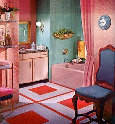 Love the red/pink with the teal green.  Also the big mod design on the floor with the traditional wallpaper.  Love everything here but that awful chair.