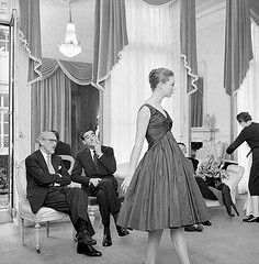 Designer Ronald Paterson discussing one of the high-waisted designs from his latest collection with fashion expert James Laver, photo by Frank Martin,1958