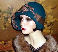 Asymmetrical brim 1920's flapper cloche hat