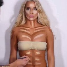 That's one way to tone up! Mesmerizing video shows a make-up artist contouring a model's entire TORSO - including her abs, her shoulders and even her cleavage