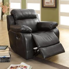 $529 - Bonded leather upholstery with a rich black finish defines a look of sophistication for this reclining chair. This elegant chair features sinuous inner springs for ultimate comfort.