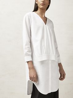 Contemporary Fashion - sporty white shirt dress with layered silhouette; reinvented fashion details // COS