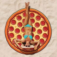 Nom Nom Nom Nom…  Pep-peroni up your sun worshiping game to a whole new level with the cheesiest of cheesy awesomeness... fresh out of our product oven... may we introduce to you our extra cheesy Gigantic Pepperoni Pizza Beach Blanket!  This masterpiece measures an impressive 5 feet long!  Take that NY size pizza!