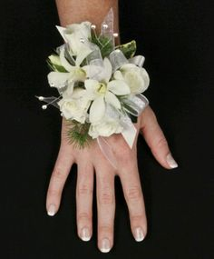 denro orchid wrist corsage, Flowers of Charlotte loves this! Visit us at… Prom Corsage And Boutonniere, Corsage Wedding, Wedding Bouquets, Boutonnieres, Corsage Formal, White Corsage, Flower Corsage, Prom Flowers, Wedding Flowers