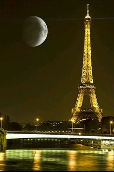 Beautiful night in Paris Moon in Paris - And now we know exactly why the City of Lights is Romantic. It just doesn't get any better than this.
