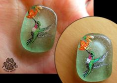I painted Hummingbird on natural shape sea glass. the glass size = 25mm