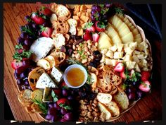 Beautiful cheese platter... Combination of soft and hard cheeses, fruits and nuts, baguette slices and a great chutney or honey