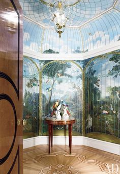 A vestibule outside the master bedroom of a London apartment was painted by Frederik Monpoint with a trompe l'oeil birdcage—where the birds are on the outside. The porcelain birds are 19th century.  DESIGNER: JP Molyneux Studio Ltd. PHOTOGRAPHER: Andrew Twort