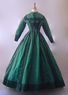 Gorgeous silk green silk dress with black velvet trim. This has a matching jacket.