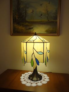 This Tiffanys lamp is a real handmade masterpiece. The lamp was made by Tiffanys method with colourful double sided opalescent stained glass -