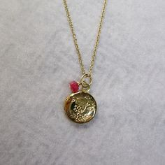18k yellow gold locket with red ruby bead by sticksandstonesny, $45.00