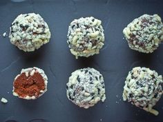 """Deck the Ramen Ball"""" cookies. Ingredients ½ cup heavy cream 8 ounces 70% dark chocolate, finely chopped (about 1½ cups) 1 (4.2-ounce) pack ramen (the cheap stuff that when eaten raw tastes like crackers) 2 tablespoons roasted black sesame seeds Maldon sea salt or fleur de sel"""