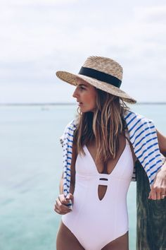 I love the hue and material of the hat! I also love the striped cover-up!