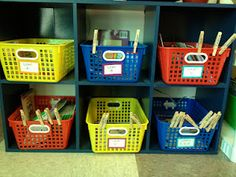 When the kids take a book from the basket they clip their name clothespin to the basket so they know where to put it away.  Clever!