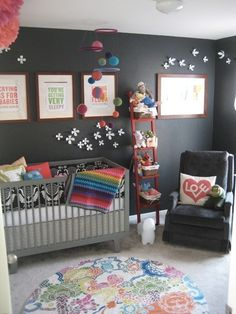 This is the inspiration for Jonesy's nursery. Grey walls with teal, purple, poppy red, pink, yellow, and green decorations (blankets, pictures, rug, etc)