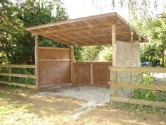 Pasture shelter outside fence line with  fewer areas for the horses to get cornered I like this idea :)