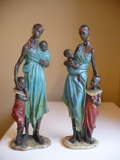 TWO AFRICAN WOMEN WITH CHILDREN STATUES