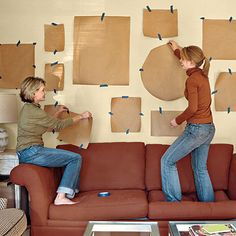 Trace photos and wall art in craft paper then you can play with the arrangement on the wall before nailing in the pictures and know where to put nails.