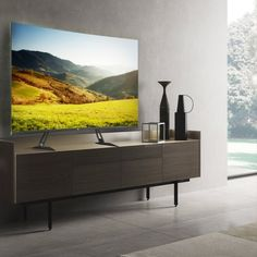 This wood floor TV stand with mount will fit most 32 37 40 42 43 46 47 50 55 60 65 70inch Plasma LED LCD flat and Curved Screens, compatible with Samsung, Sony, LG, TCL, Hisens, Sharp, Insignia, Vizio, Haier, Toshiba, Element, Westinghouse, Curtis, Dynex and so on. To make sure this mount will fit, you should insure your TV's VESA bolt pattern at back of tv falls between these two sizes : 200mm x 200mm up to 600mm x 400mm Mobile Tv Stand, 70 Inch Tvs, Wooden Storage Shelves, Universal Tv Stand, Black Tv Stand, Swivel Tv Stand, Tv Stand With Mount, Tempered Glass Shelves, Tv Bracket