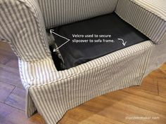 Custom ticking stripe slipcover attached with Velcro at inside sleeper sofa frame.