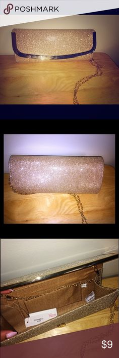 Gold clutch Brand new gold clutch with tags. Bags Clutches & Wristlets