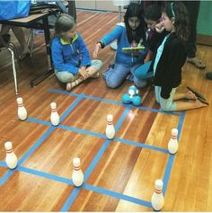Coding projects for kids: Set up challenges like programming Dot and Dash to knock down bowling pins