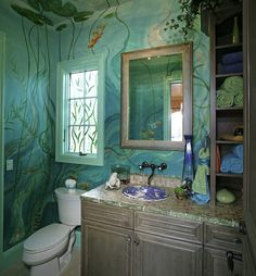 Small Bathroom: painted to look like under water in a lake the ceiling being the surface wiyh water lillies